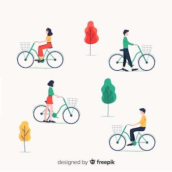 Ludzie jadący na rowerze w kolekcji parku