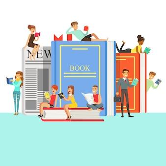 Ludzie, którzy lubią czytać książki wokół gigantycznych książek z twardą okładką i gazetą