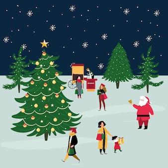 Ludzie kupują prezenty świąteczne w zimie