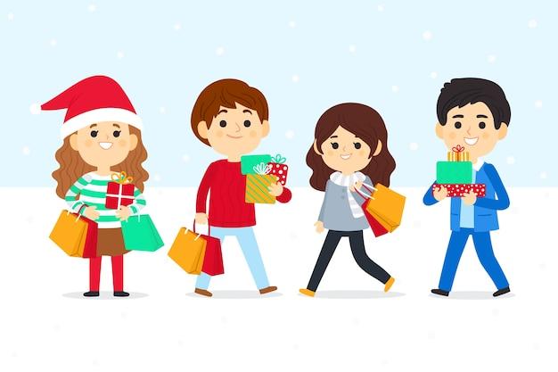 Ludzie kupujący zestaw świąteczny prezenty