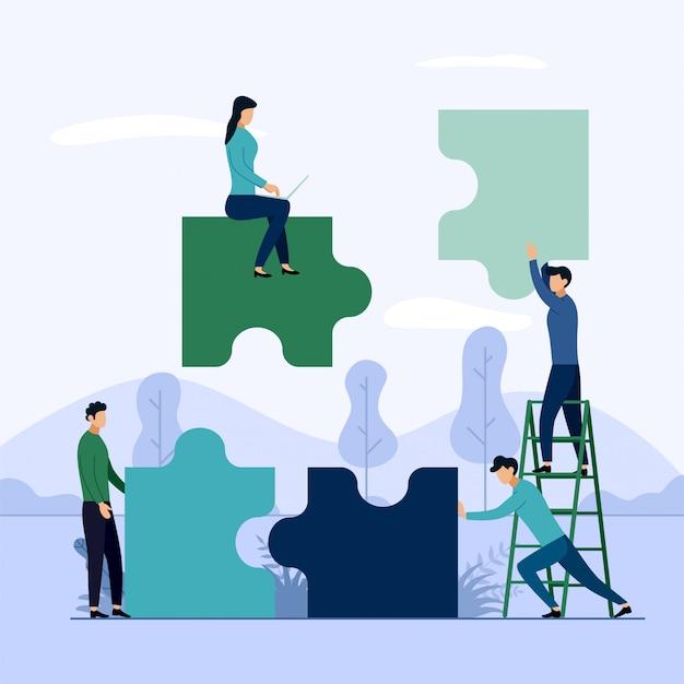 Ludzie łączący elementy puzzli