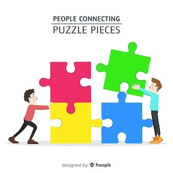 Ludzie łączący elementy układanki