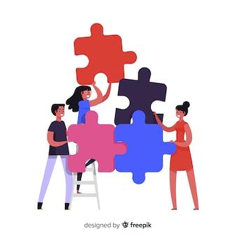 Ludzie łączący kawałki układanki