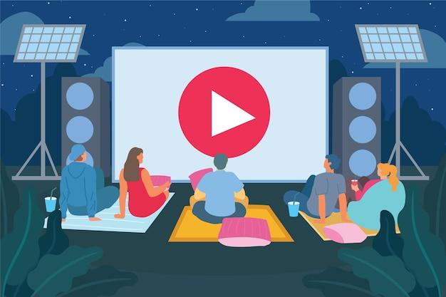 Ludzie na kocach kino na świeżym powietrzu