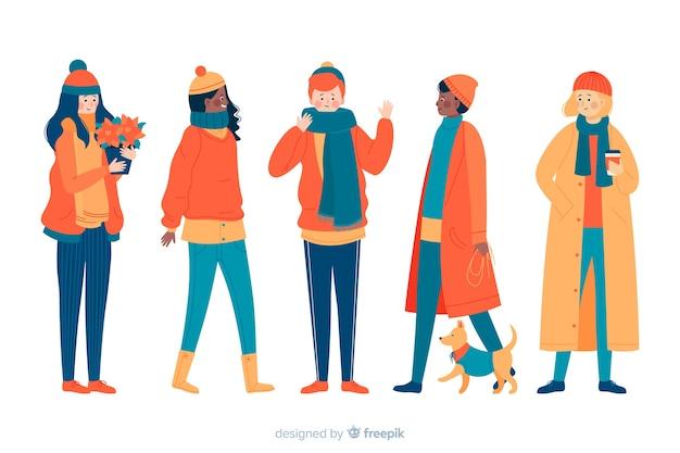 Ludzie noszący kolekcję ubrań zimowych