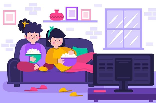 Ludzie oglądają film w domu