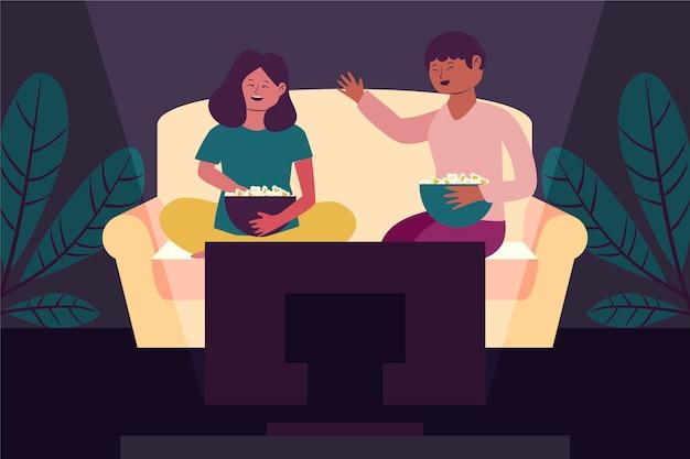 Ludzie oglądają razem film w domu