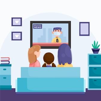 Ludzie oglądają wiadomości w domu