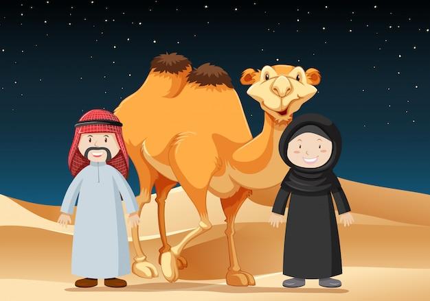 Ludzie podróżują na pustyni z wielbłądem