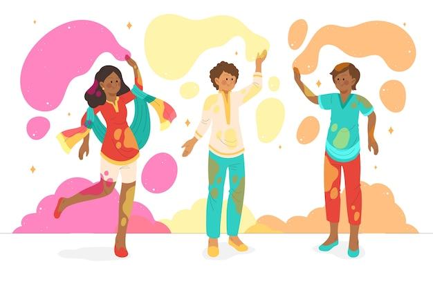 Ludzie poplamieni farbą spędzają czas na festiwalu holi
