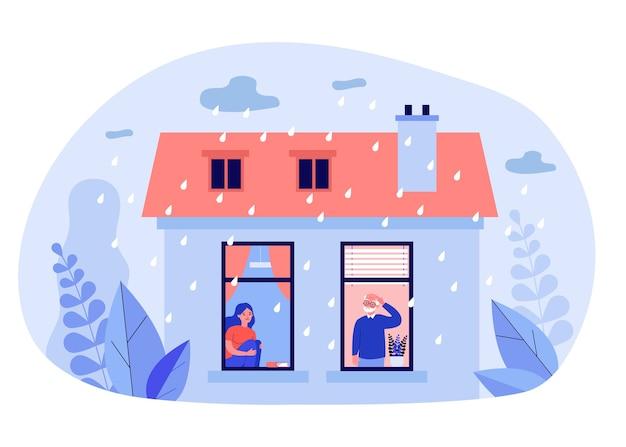 Ludzie przebywający w domu podczas deszczowej pogody