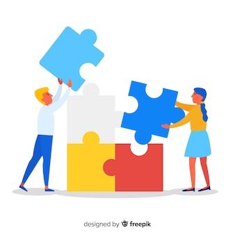 Ludzie robią puzzle razem