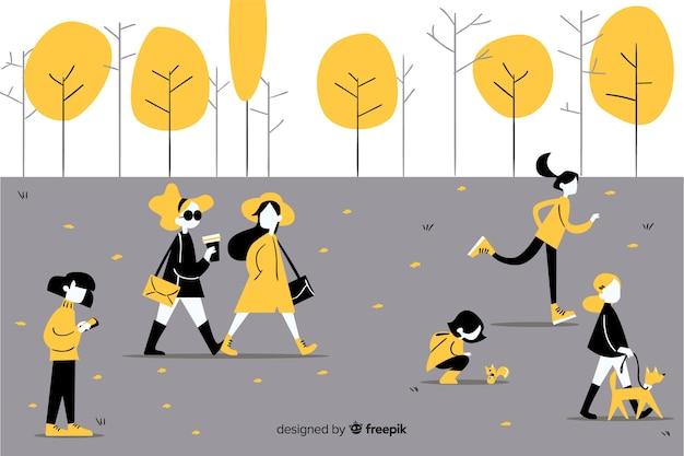 Ludzie robią zajęcia w parku jesienią