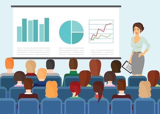 Ludzie siedzący i oglądający prezentację na ekranie