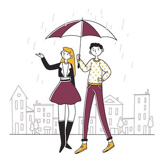 Ludzie stojący pod parasolem w deszczowy dzień