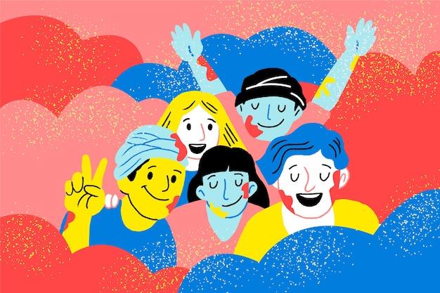 Ludzie świętują holi festiwal otoczony farbą