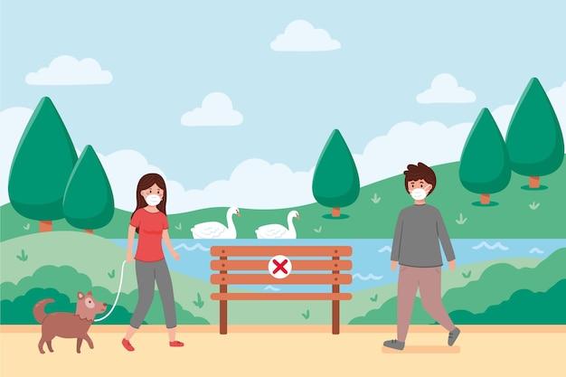 Ludzie trzymający dystans społeczny w parku