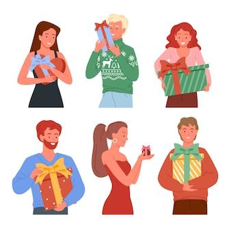 Ludzie trzymający prezenty, pudełka na prezenty świąteczne. szczęśliwi przyjaciele biorą i dają prezenty.