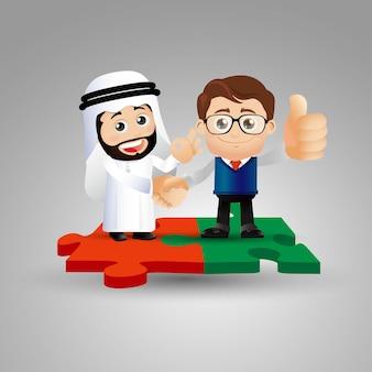 Ludzie ustawiają arabów stojących na kawałkach puzzli