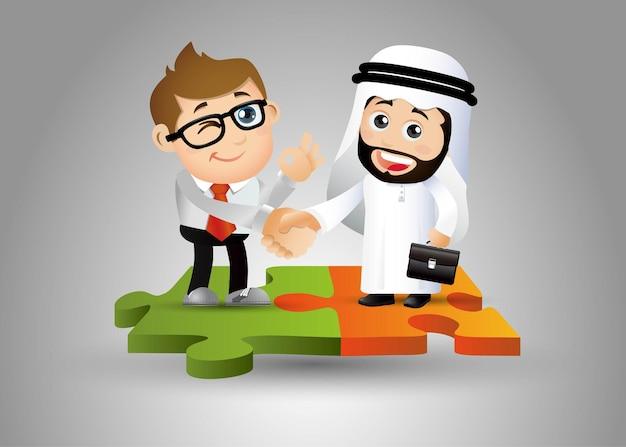 Ludzie ustawiają arabów stojących na kawałkach układanki