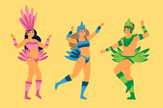 Ludzie w akcesoriach z monochromatycznych piór tańczących brazylijską kolekcję karnawałową