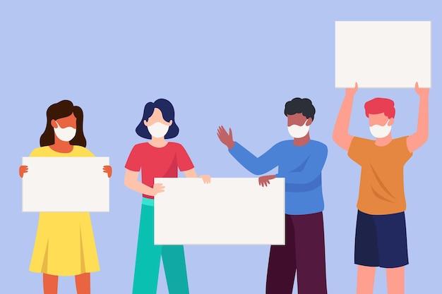 Ludzie w maskach medycznych z ilustrowanymi plakatami