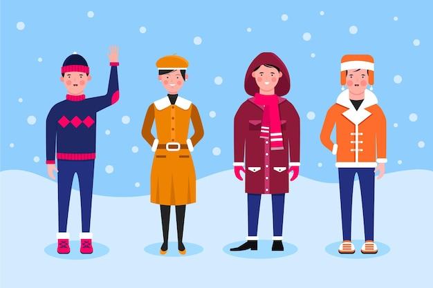 Ludzie w przytulnych ubraniach zimą