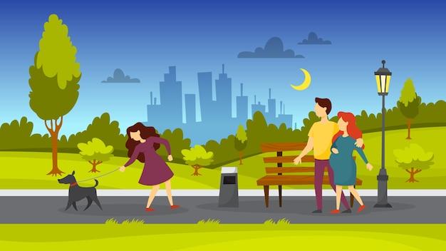 Ludzie w publicznym parku. wyprowadzanie psa