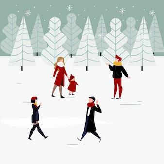 Ludzie w zimowych ubraniach cieszą się zimowym dniem