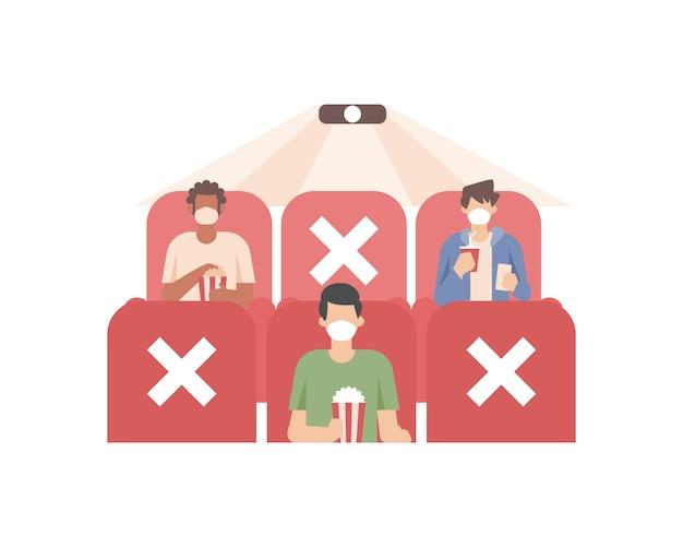 Ludzie z powrotem oglądają kino w kinie, wciąż nosząc maskę na twarzy i wykonując protokoły bezpieczeństwa, takie jak zachowanie dystansu społecznego przez nie siedzenie, aby się zamknąć ilustracja