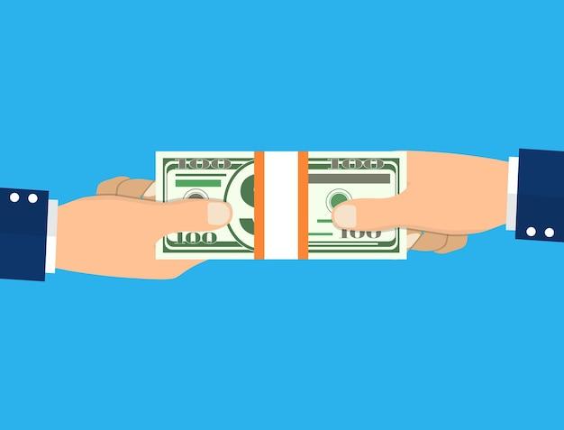 Ludzka ręka daje pieniądze z drugiej strony.