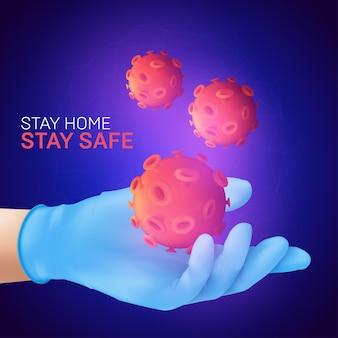Ludzka ręka jest ubranym błękitną lateksową rękawiczkę medyczną trzyma komórkę koronawirusa. zostań w domu. bądź bezpieczny.