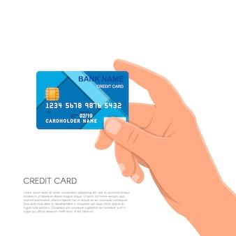 Ludzką ręką, trzymając kartę kredytową banku.