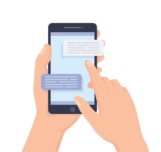 Ludzką ręką trzymając telefon komórkowy z wiadomościami tekstowymi