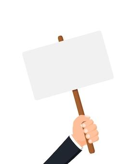 Ludzka ręka trzymająca pustą tabliczkę na projekt banera protest rewolucji politycznej demonstruje