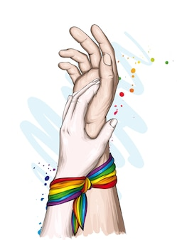 Ludzkie ręce i tęczowa wstążka lgbt