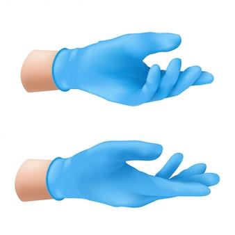 Ludzkie ręce w niebieskich lateksowych rękawiczkach medycznych.