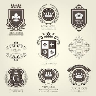 Luksusowe heraldyczne emblematy i odznaki z tarczami i koronami