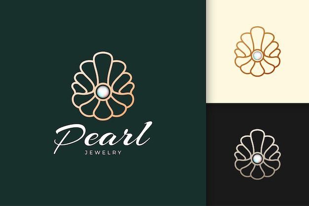Luksusowe i wysokiej klasy perłowe logo w kształcie muszli reprezentuje klejnot lub klasę