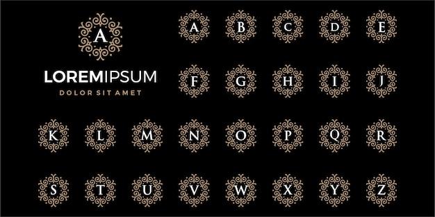 Luksusowe złote logo firmy inicjały