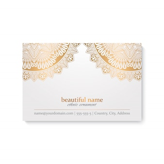 Luksusowy szablon wizytówki w stylu indyjskim, białym i złotym kolorze