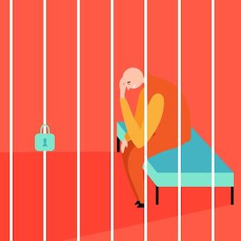 Łysy więzień siedzi za kratami