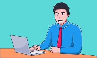 Młody biznesmen pracuje na laptopie