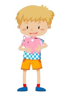 Młody chłopak gospodarstwa piggy bank