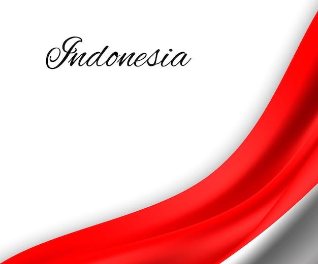 Macha flagą indonezji na białym tle.