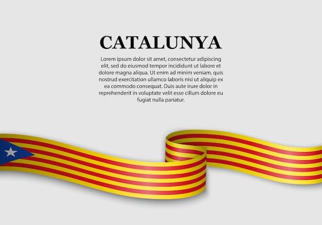 Macha flagą katalońskiego niezależnika