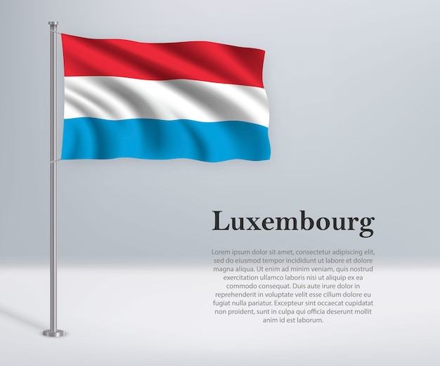 Macha flagą luksemburga na maszcie