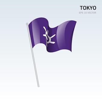 Macha flagą prefektur tokio w japonii na białym tle na szarym tle