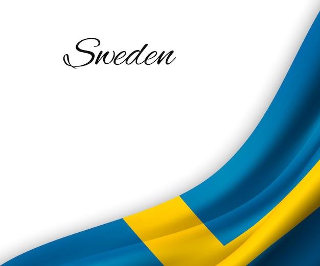 Macha flagą szwecji na białym tle.