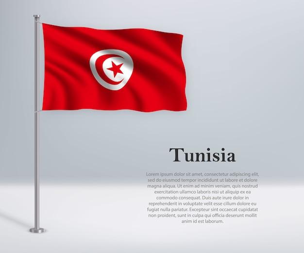 Macha flagą tunezji na maszcie
